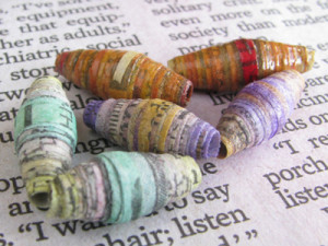 Watercolor newspaper beads with different color combinations.