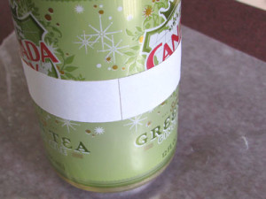 Scrapbook paper strip wrapped completely around the can.