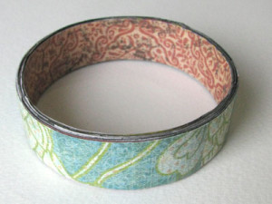 Wrap the outside of the bracelet with decorative paper.